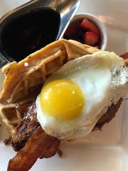 Chicken and waffles at Superior's Steakhouse is a hearty breakfast that hits a lot of satisfying flavor and texture notes.