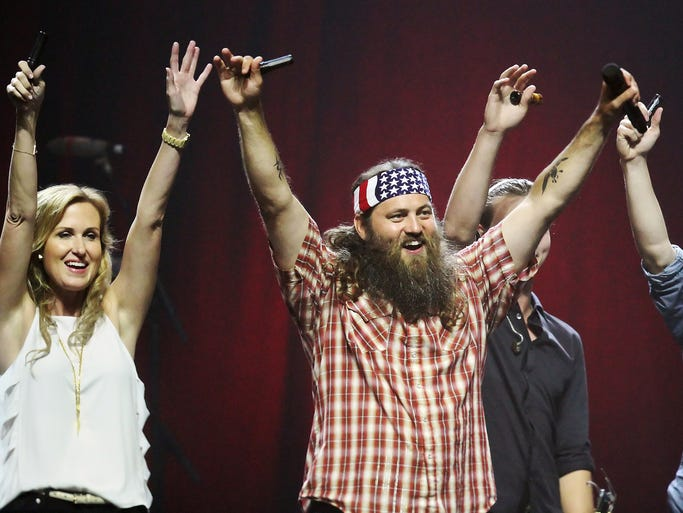 Duck Dynasty's Willie Robertson, center, and Robertson family members celebrate setting a Guinness World Record for largest number of people doing a duck call Sunday at Germain Arena in Estero.