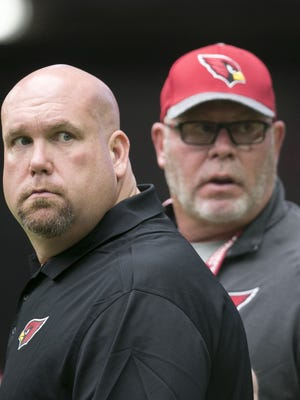 Cardinals general manager Steve Keim (left) and head coach Bruce Arians look on during a Cardinals' training camp practice at University of Phoenix Stadium in Glendale on Wednesday, Aug. 10, 2016.