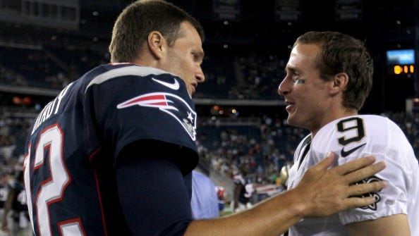 Tom Brady of the New England Patriots chats with  Drew Brees of the New Orleans Saints after preseason game at Gillette Stadium on August 9, 2012 in Foxboro, Massachusetts.