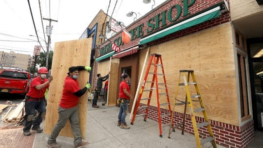 The Irish Coffee Shop on McLean Avenue in Yonkers is boarded up to prevent damage from vandals. Nearby stores had windows broken the night before.