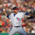 Iowa pitcher Dallas Beeler fires a pitch against Omaha at Principal Park in Des Moines, Iowa, on Thursday, July 3, 2014.