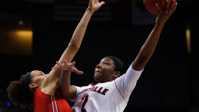 Louisville forward Myisha Hines-Allen (2) shoots over Dayton center Jodie Cornelie-Sigmundova, of France, during the second half of a women's college basketball regional semifinal game in the NCAA Tournament on Saturday, March 28, 2015, in Albany, N.Y. (AP Photo/Mike Groll)