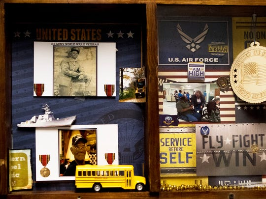 The left side of a shadow box on the wall outside Floyd Simmons' room at the Northeast Louisiana Veterans Home showcases photographs from his time in the Army and a model school bus like the one he used to drive. Simmons served in the Army during World War II. He was based in the Philippines and served from 1941 to 1945.