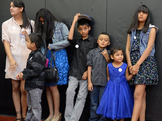 The Rodriguez family waits to have their family photo
