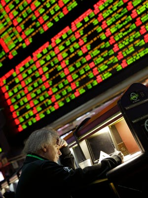 A man looks through Super Bowl proposition bets at the Westgate Superbook Race and Sportsbook in Las Vegas.