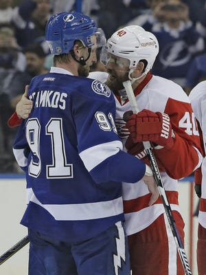 Detroit Red Wings left wing Henrik Zetterberg, right, congratulates Tampa Bay Lightning center Steven Stamkos after a playoff series April 29, 2015, in Tampa.