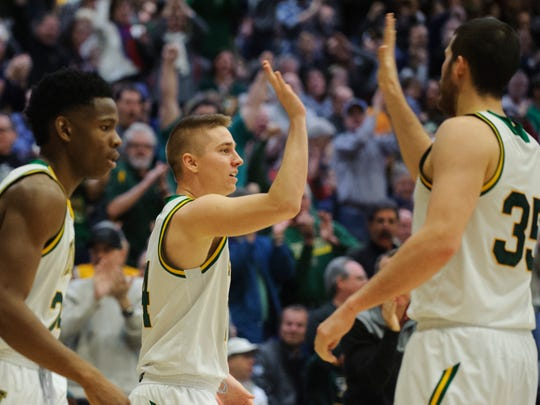 Vermont's Payton Henson (35) high fives Cam Ward (14) during the men's basketball game between the Stony Brook Seawolves and the Vermont Catamounts at Patrick Gym on Saturday afternoon January 13, 2018 in Burlington.