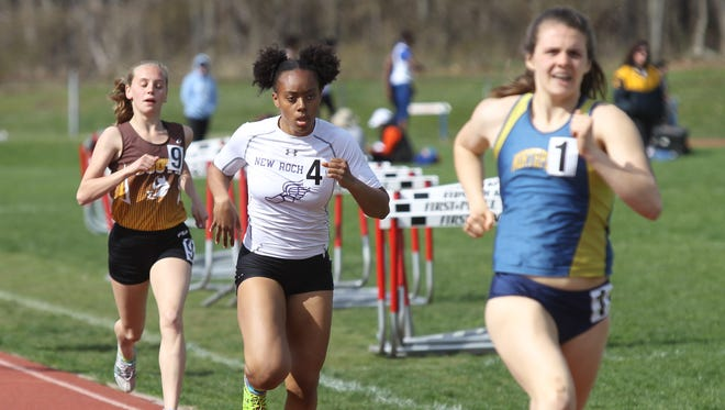 New Rochelle's Jeanneney Currie (center) runs the 800-meter run of the pentathlon during day two of the 30th annual Red Raider Relays at North Rockland High School in Thiells on Thursday, April 13, 2017.