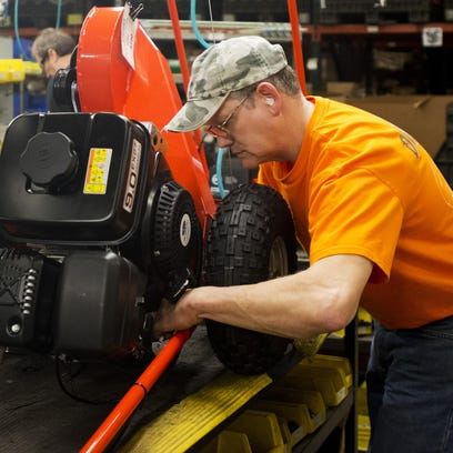 Harold Townsend, an assembly worker at DR Power Equipment, works on a machine in 2013 at the company's Winooski manufacturing plant.
