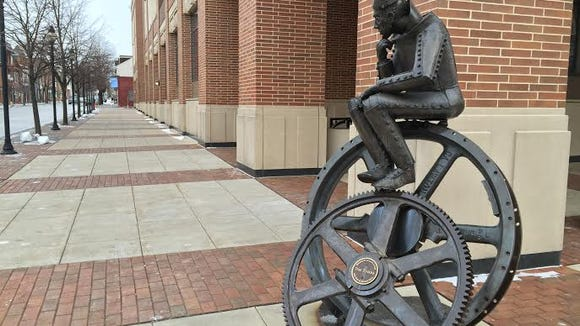 The sculpture says 'The Tinker.'  Sculptor Lorann Jacobs