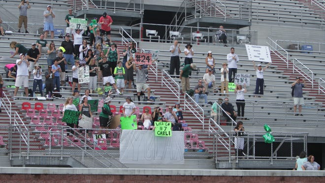 Yorktown fans with their signs before the New York State girls lacrosse Class B state final between Yorktown and Garden City at SUNY Cortland on Saturday, June 11th, 2016. Garden City won 16-5.