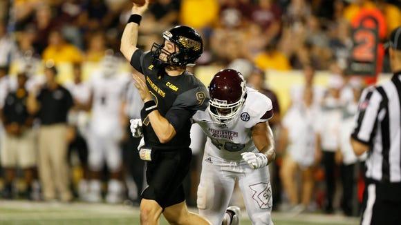 Southern Mississippi quarterback Nick Mullens (9) passes