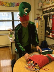 Buddy the Elf, played by Andrew Wellmann, helped St. Nicholas pass out candy to students Friday at St. Peter's Elementary and Montessori School. Students and staff celebrated the Feast of St. Nicholas.
