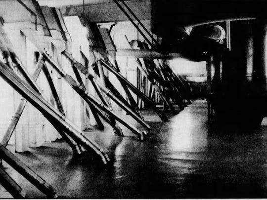 A 1986 photos shows large filters at the top of the mill with tubes extending down to four-way sifters on the next floor, where milled wheat was separated into grades.