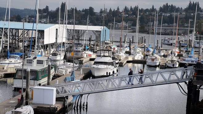 Port of Bremerton commissioners last week approved a contract for a firm to design the replacement of Port Orchard Marina's aging breakwater.