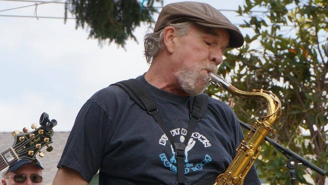 Saxophonist Derral Campbell performs.