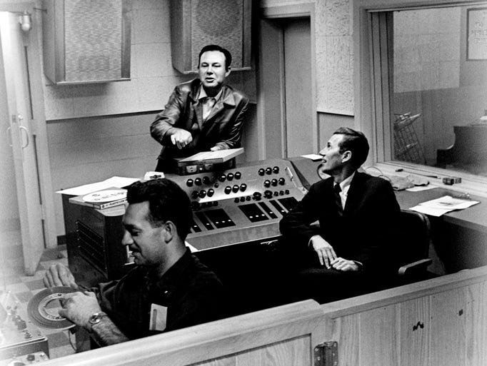 Jim Reeves, center, works with Chet Atkins, right, RCA manager of Nashville operations, in the RCA studio Oct. 19, 1962. Reeves is recording his first Christmas album for RCA Victor.