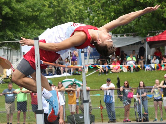 Shelby's Uriah Schwemley cleared 6 feet-6 inches to win the high jump in Saturday's Division II regional track meet at Lexington High School.