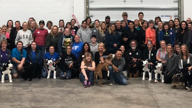 """Dog trainers and behavior consultants Trish McMillan Loehr and Michael Shikashio presented  """"Aggression in Dogs: Safety, defensive handling and training,"""" which the Best Behavior Dog Training team attended in St. Petersburg. Pictured are all the seminar's attendees."""