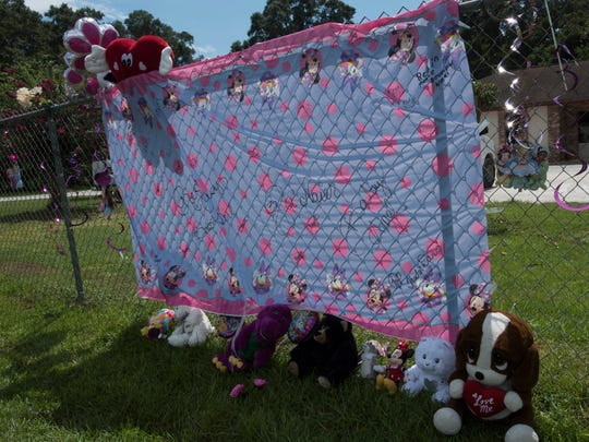 A makeshift memorial has been erected outside In His Arms Christian Academy Wednesday, Aug. 23, 207. The memorial sprang up after the death of a three-year-old at the daycare facility on Friday, Aug. 18.