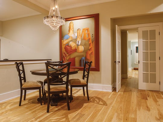 The homeowners, who also own an art gallery, have artwork throughout the home.