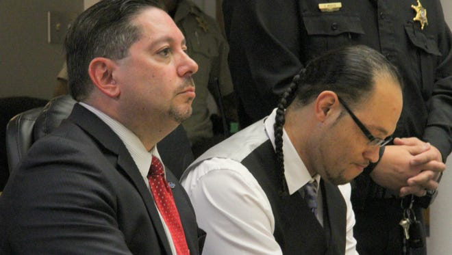 El Rico Cummings lowered his head after he was found guilty in 12th Judicial District Court of kidnapping, conspiracy to commit kidnapping, tampering with evidence, aggravated battery-deadly weapon and possession of a firearm by a felon.