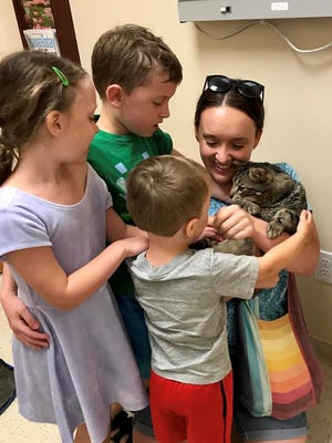 Redick family was reunited with their missing cat, Barry, on Wednesday.