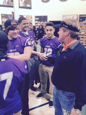 Jon Gruden meets with Green Bay West players Saturday night at Dick's Sporting Goods in Ashwaubenon.