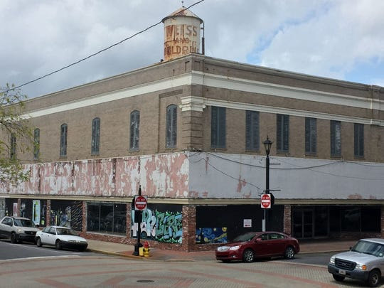 Designating downtown Alexandria as a historic district could open up new development opportunities through access to tax credits. The Weiss and Goldring building at the corner of 3rd and Desoto streets is a prime example.