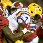 LSU Tigers running back Leonard Fournette (7) is brought down by Alabama Crimson Tide defensive lineman A'Shawn Robinson (86) during the third quarter at Bryant-Denny Stadium.