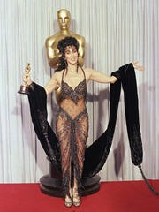 Cher backstage with her Oscar for 'Moonstruck.'