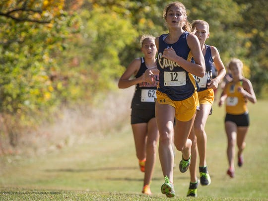 Delta's Brittany Tuttle leads a small pack of runners in the final stretch of the IHSAA Sectional Oct.7 at the Muncie Sportsplex. Muncie Central won the sectional for the boys and Delta won the sectional for the girls.