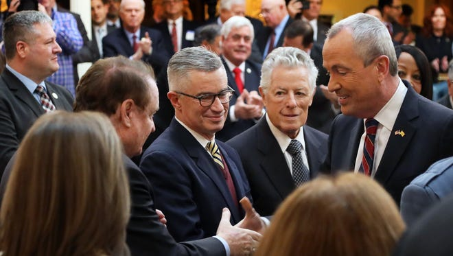 Former Governors Richard Codey, Jim McGreevey and Jim Florio greet Governor Phil Murphy as he enters the Assembly chambers to give his budget address.
