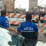 Police monitor SXSW attendees.