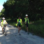 Bikers and hikers arrive at the finish of the trail journey from Volusia County into north Brevard County.