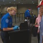 TSA agent checks travelers ID at Boise Airport.