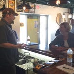 Stillmank Brewing Co. owner Brad Stillmank talks with U.S. Sen. Tammy Baldwin, D-Wis., at the company's Henry Street brewery and tap room.