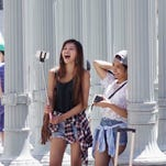 Tourists at Los Angeles County Museum of Art taking selfies with their sticks