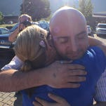 William Smith Jr. received a hug from supporter Sarah Anderson as he headed into  the Rowan County Courthouse on Thursday.