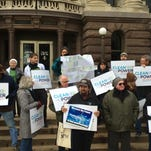 About 20 conservationists held a rally on the steps of the Brown County Courthouse Friday.