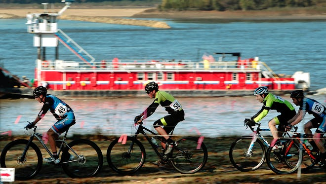 November 9, 2014 -  Cyclists in the B race ride alongside a tugboat down the straight-away Sunday morning during the 2014 Outdoors Inc Cyclocross Championships at Greenbelt Park on Mud Island. The 28th annual Memphis cyclocross race is the longest running cyclocross event in the country. (Jim Weber/The Commercial Appeal)
