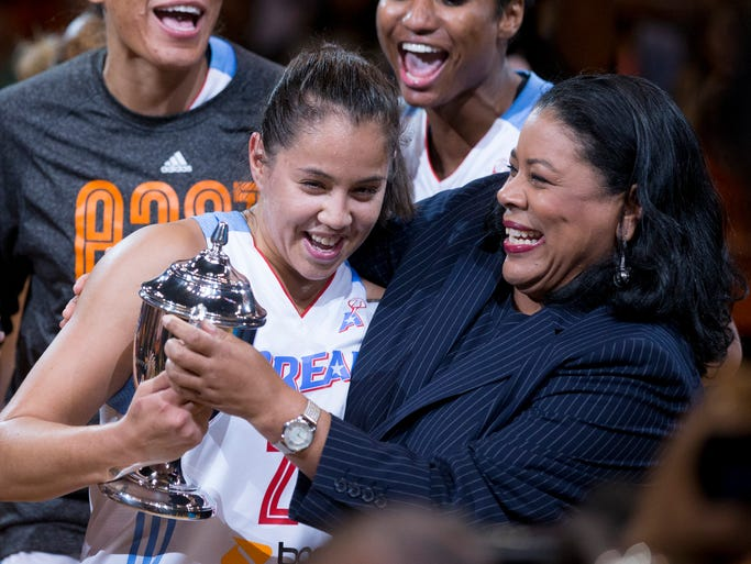 East guard Shoni Schimmel gets a hug from WNBA President Laurel Richie after being named the MVP of the 2014 All-Star Game in Phoenix.