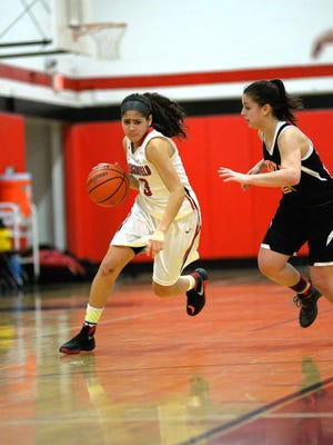 Bergenfield senior Isabel DeLeon dribbles around a Tenafly defender. DeLeon tallied a game-high 17 points in the Bears win.