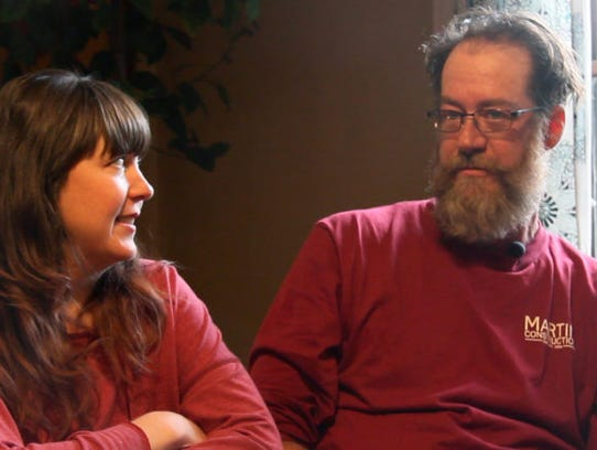 Jen and Ted Knights speak at their Iowa City home on