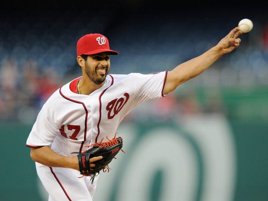 Washington Nationals starting pitcher Gio Gonzalez (47) delivers a pitch against the Miami Marlins during the first inning of a baseball game, Tuesday, April 8, 2014, in Washington. (AP Photo/Nick Wass)