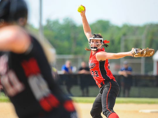 Laurel starting pitcher Regan Green throws to a Polytech