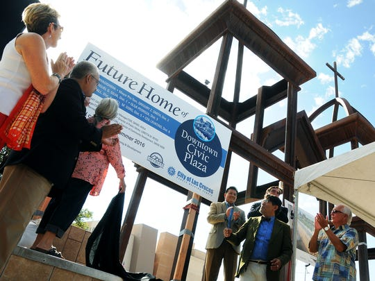 """Las Cruces dignitaries unveil the """"Future Home"""" sign for the Downtown Civic Plaza on Friday at the base of the St. Genevieve Monument. The project is expected to be complete in the summer of 2016."""