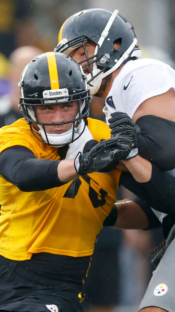 Pittsburgh Steelers linebacker T.J. Watt, left, tries to get around a block by tackle Alejandro Villanueva during practice at NFL football training camp in Latrobe, Pa., Friday, July 28, 2017. (AP Photo/Keith Srakocic)