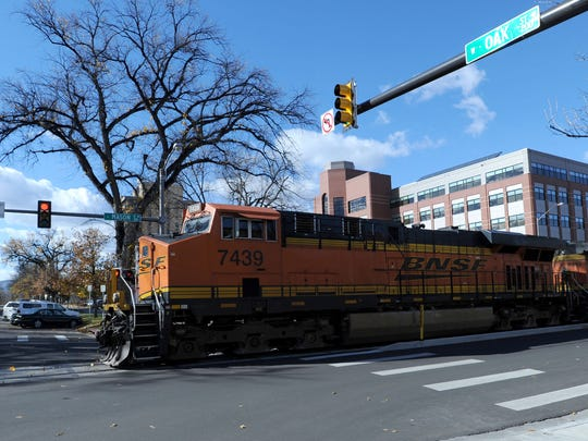 A BNSF Railway train crosses Oak Street in downtown Fort Collins in this file photo. BNSF has been running trains that are up to 3 miles long through the city in recent months.